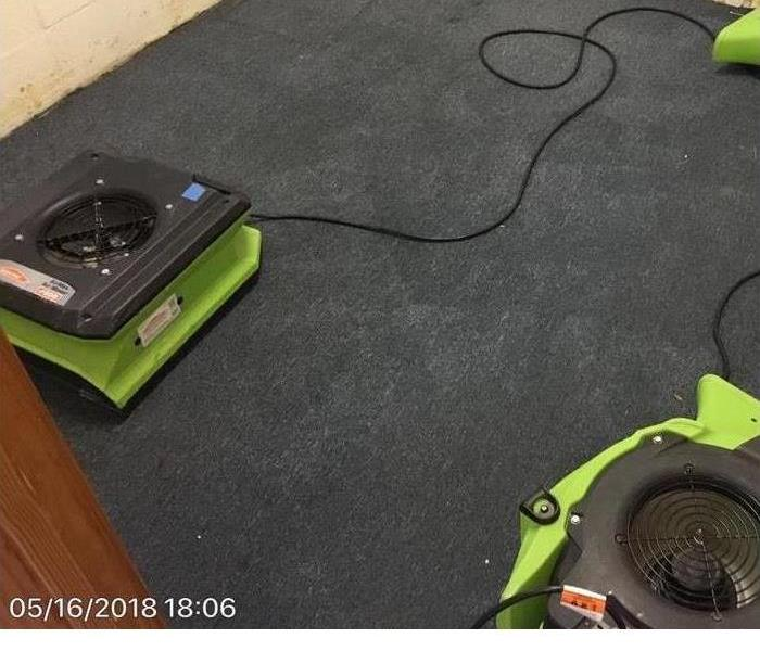 SERVPRO air movers sit on dried carpet