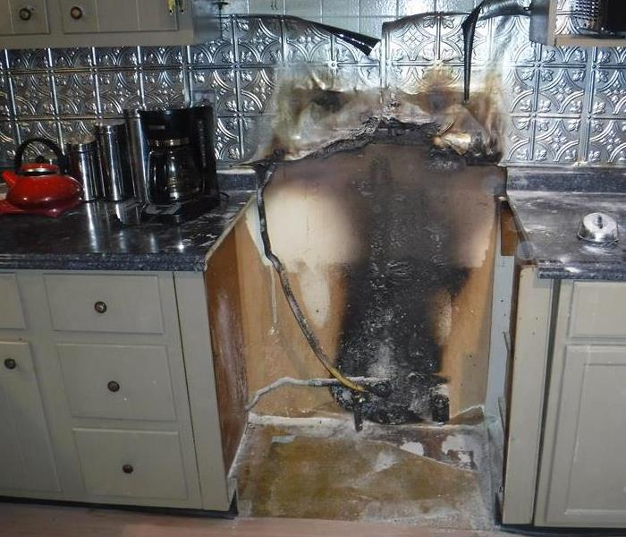 a stove that has been completely destroyed by fire