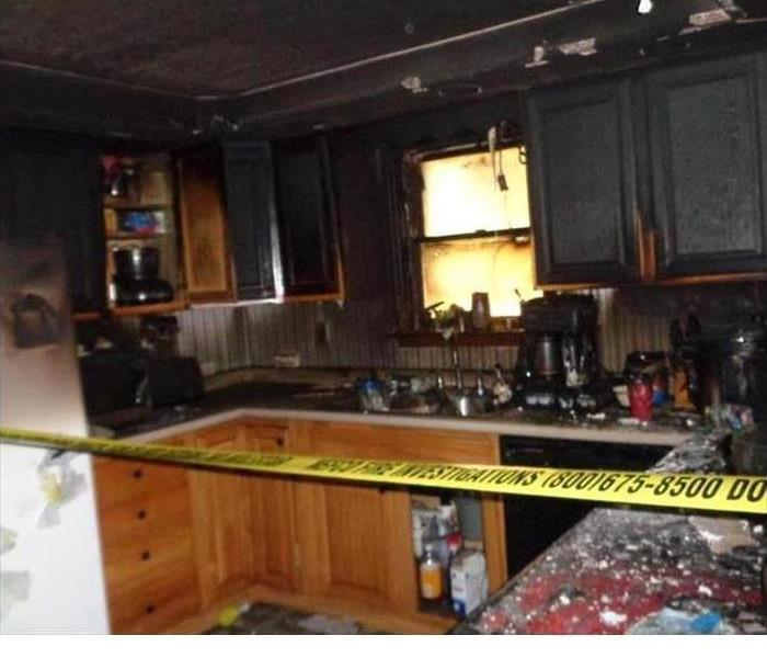 a kitchen that has been destroyed by fire
