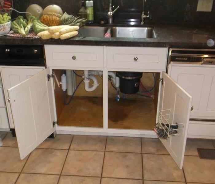 Under kitchen sink leak | SERVPRO of Vigo County